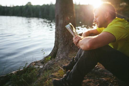 Adventurer reading a Map