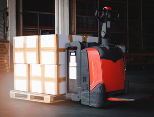 Shipment, Cargo freight, Delivery. Logistics and transportation. Electric forklift pallet jack with...