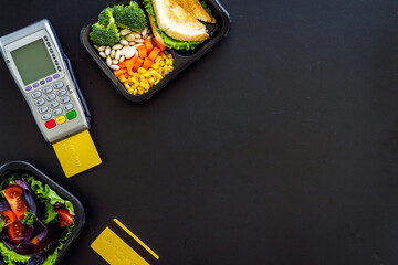 Food delivery payment with terminal and lunch boxes with meal
