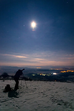 Person taking photo of the night sky
