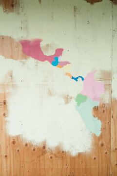 A map of Central America painted on the side of a board.