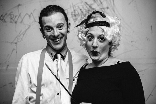 Black and white portrait of a couple dressed as Gangsters from the 1920s