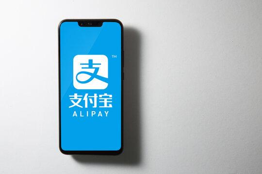 Kuala Lumpur, Malaysia - AUGUST 10, 2020: Alipay logo on screen of Huawei Nova 3i.