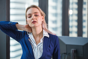 Business worker feeling tired frustrated stressed from hard work and massage necks to relieve pain and tension from office syndrome.