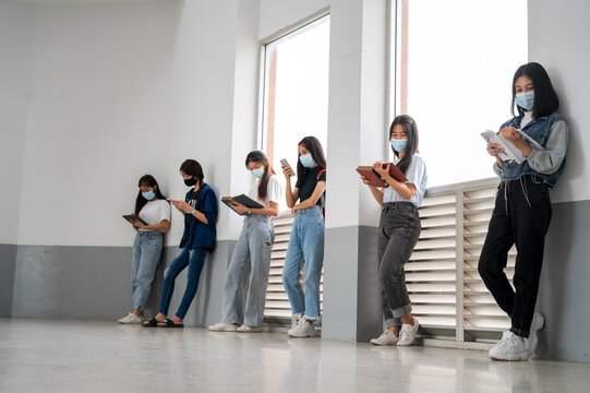 teenage with face mask back at school after covid-19 pandemic quarantine and lockdown,Avoid the spread of coronavirus and social distance