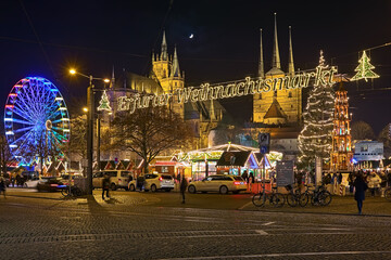 Erfurt, Germany. Christmas market at Domplatz (Cathedral Square) on the background of St Mary's Cathedral and Church of St Severus in night.