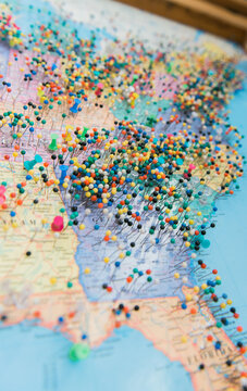 Push pins on a map of the United States