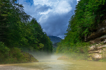 alpine river with the mist