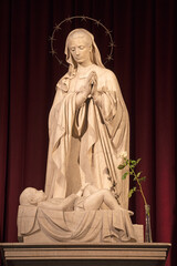 BARCELONA, SPAIN - MARCH 3, 2020: The marble sculpture of Madonna over the crib in the chruch Iglesia de Belen by Joan Rebull (20. cent.).