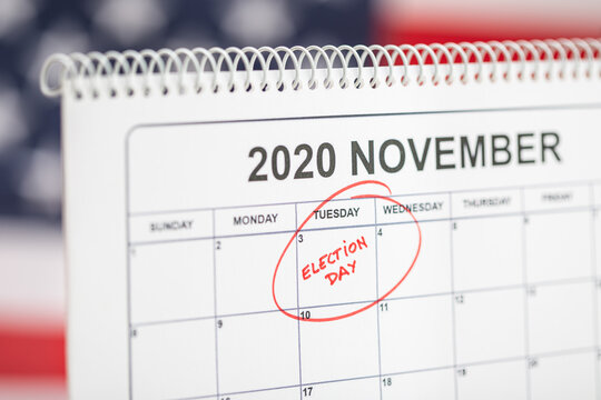 November 3, 2020 Election day concept. Desk calendar with November 3rd marked in red and USA flag at background