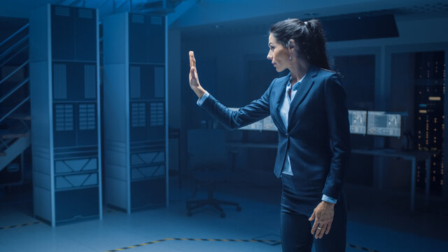 In Modern Data Center Research Laboratory Beautiful Confident Woman Does Virtual Reality Activating Touch Gesture. Mock-up Augmented Reality Shot.