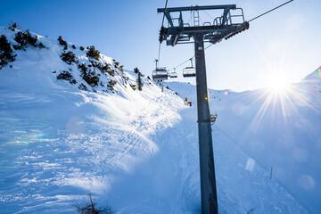 Gondola lift on the snowy slopes of the Brenta Dolomites - Alps