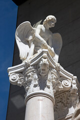 MARIAZELL, AUSTRIA - SEPTEMBER 13, 2015: The marble corinthian column with the statue of angle at the Basilica.
