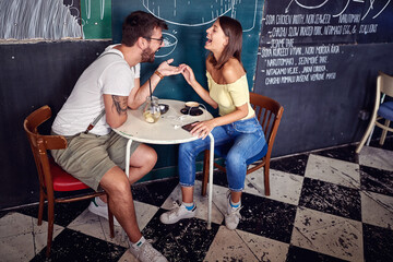 Young couple enjoying in a cafe