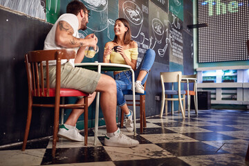 Young couple enjoying the drink in a cafe