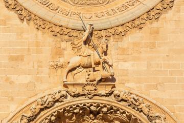 PALMA DE MALLORCA, SPAIN - JANUARY 27, 2019: The St. George statue on the baroque portal of church Iglesia de San Francisco by Pere Horrach and Francisco de Herrera (second half of the 17. cent.).