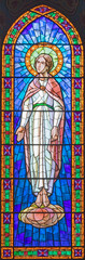 BARCELONA, SPAIN - MARCH 4, 2020: The modern stained glass of Virgin Mary in church Iglesia Sant Angel Custodi from 20. cent.
