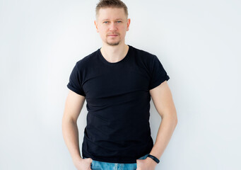 Handsome man posing in black blank t-shirt