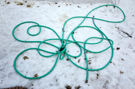 Garden hose design in snow. St Paul Minnesota MN USA