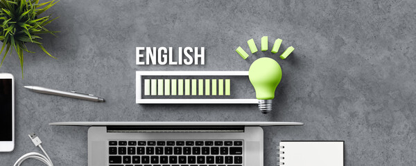 lightbulb and loading bar with the word ENGLISH and office equipment on concrete background