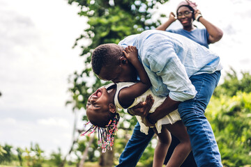 Portrait of enjoy happy love black family african american father and mother with little african...