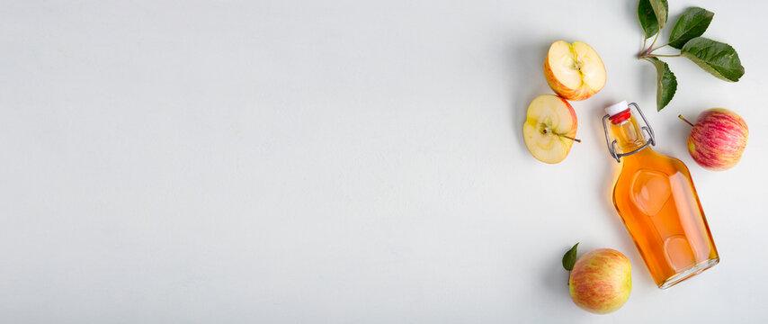 Fresh ripe apples and apple cider vinegar.