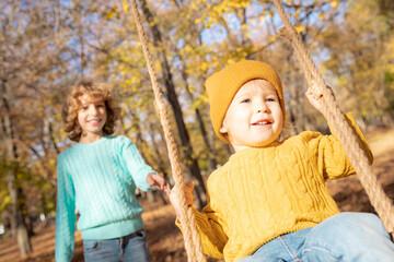 Happy children having fun outdoor in autumn park