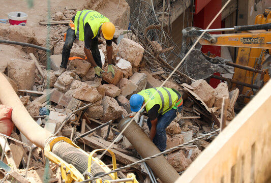 Volunteers dig through the rubble of buildings which collapsed due to the explosion at the port area, after signs of life were detected, in Gemmayze, Beirut