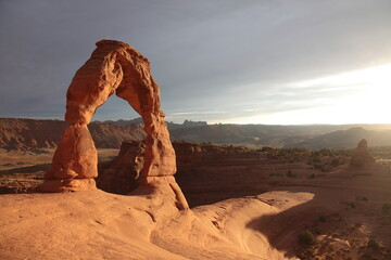 Foto auf Leinwand Braun View of Delicate Arch at Sunset in Arches National Park Utah, USA