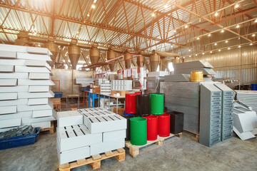 Metal mailboxes are ready to be sent to the consumer. They are in the shop of a factory for the production of metal products