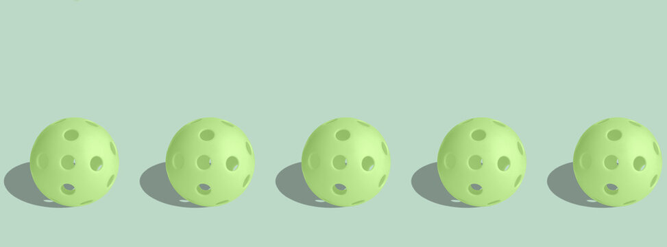 Banner green pickalball balls on a pastel green background.