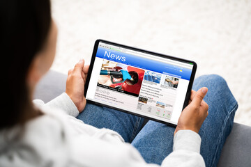 Watching News On Tablet Computer Screen Online