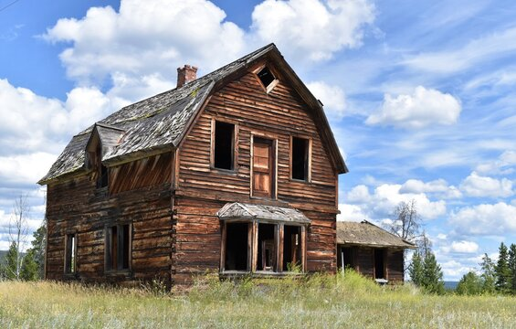 Old abandoned wooden house or barn.  Empty, broken windows.
