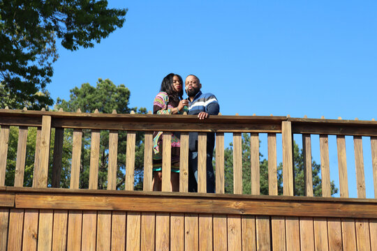 African American couple looking from a balcony on a clear day