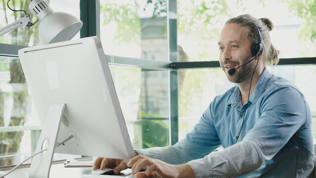 Business man talking video conference plan to work with colleague in team. Call Center staff Or doctor is giving tele health consultation. Work using communication technology. Concept Work at Home.