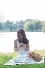 Beautiful asian women typing smartphone for social network