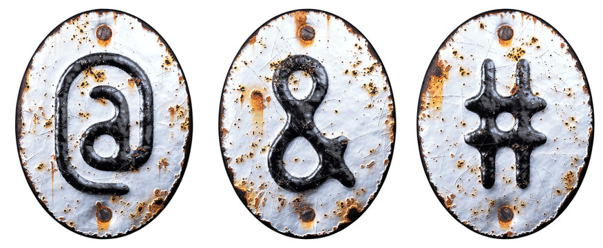 Set of symbols at, ampersand and hash made of forged metal on the background fragment of a metal surface with cracked rust.