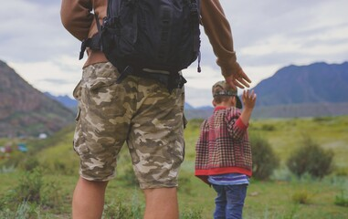 Father and son walking in the mountains