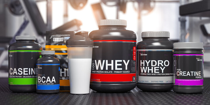 Sports nutrition supplements and chemistry for bodybuilding in gym. Whey protein casein, bcaa, creatine cans.