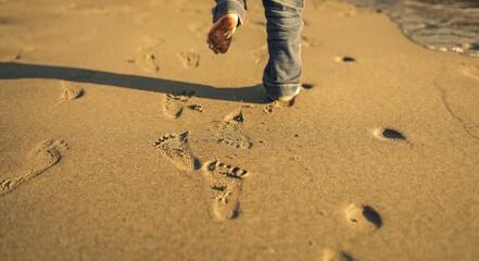 Kids fotprints on the beach