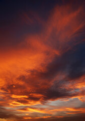 Photo sur Plexiglas Bordeaux Dark blood red sky background. Dramatic heavy clouds with the hint of the sun at sunset. Many orange tones and patterns of clouds.