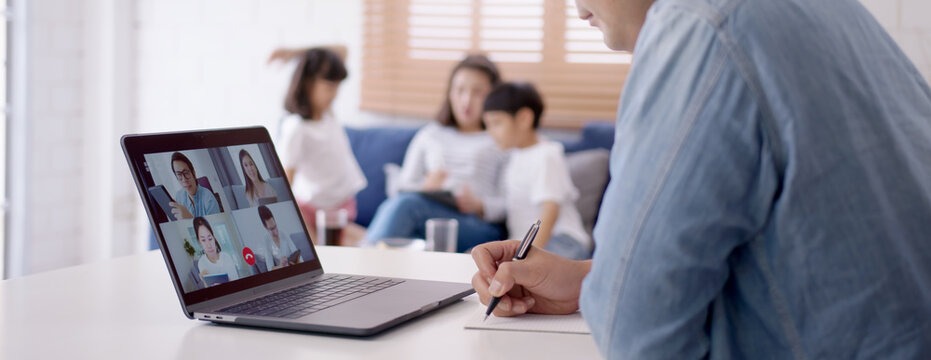 Asian business man stay with family and work remotely at home video conference remote call to corporate group. Meeting online,videocall, group discuss online concept.