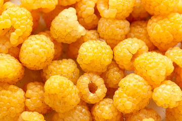 Closeup of golden raspberry fruits as background