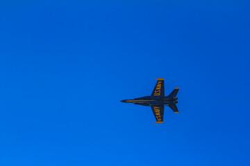 United States Navy Blue Angels aerobatic team's F-18 Hornet combat jet In flight at Fleet Week San Francisco, USA
