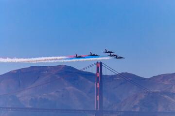 Patriots Jet Team aerobatic team's Aero L-39 Albatros jets flying over the Golden Gate Bridge in San Francisco, USA