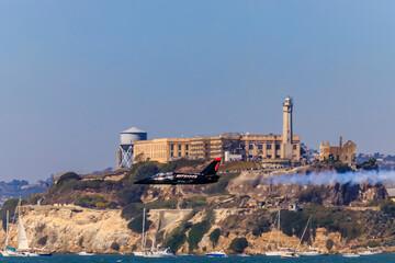 Patriots Jet Team aerobatic team Aero L-39 Albatros jets flying in front of the Alcatraz Island in San Francisco, USA