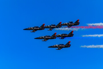 Patriots Jet Team aerobatic team Aero L-39 Albatros jets in formation with colorful contrails, San Francisco Fleet Week