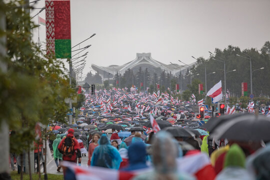 Minsk, Belarus, August 06, 2020. Red-white flags of protests in Belarus and umbrellas. It started raining on the protest march!