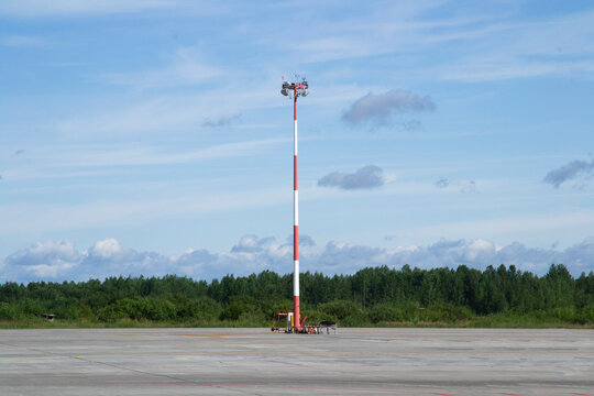 tower with spotlights on the runway. clear sunny day, blue sky background.