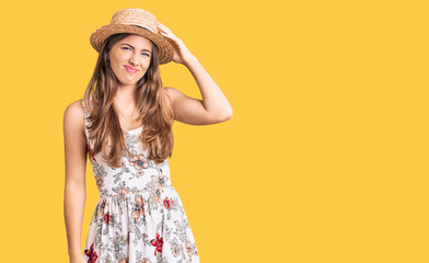 Beautiful caucasian young woman wearing summer hat confuse and wonder about question. uncertain...